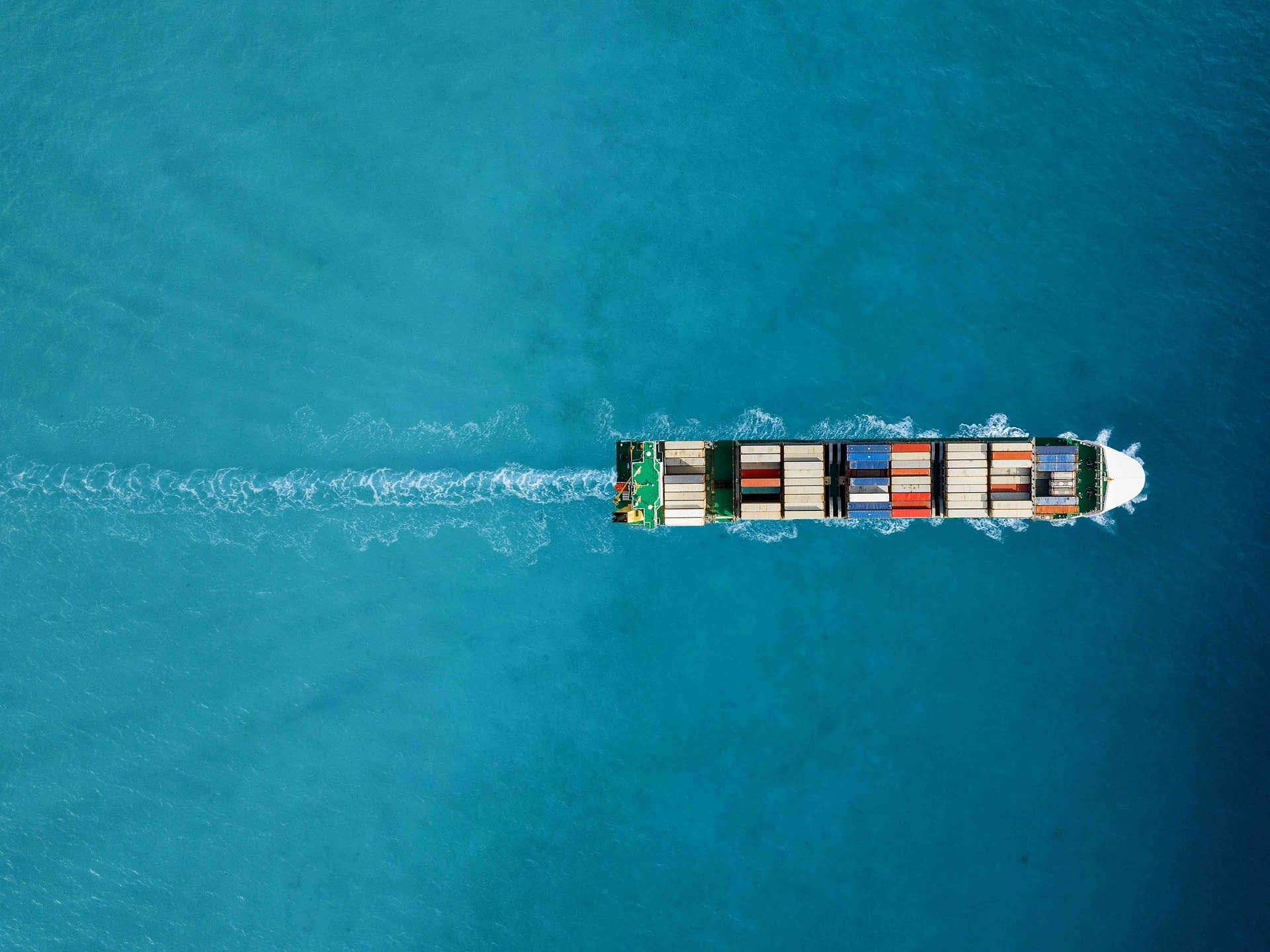 Container ship in export and import. International shipping cargo. Aerial view